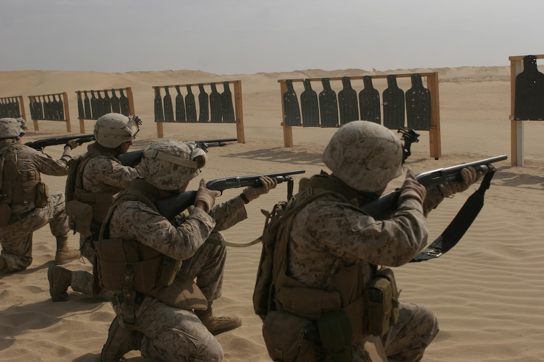Marines of Golf Company, Battalion Landing Team 2/6, 26th Marine Expeditionary Unit, fire the Mossberg 500 12-gauge shotguns while conducting sustainment training at Camp Beuhring, Kuwait, Jan. 1, 2009. The 26th MEU is currently deployed to the U.S. Central Command Area of Operation as part of its 2008-2009 deployment. (Official USMC photo by Cpl. Patrick M. Johnson-Campbell) (Released)