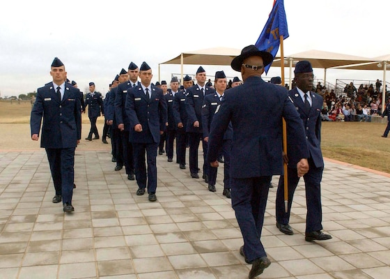 The first flight formation of Airmen preparing to graduate from basic military training march over the Enlisted Heroes Walk during the Jan. 2 ceremony at Lackland Air Force Base, Texas. (U.S. Air Force Photo/Alan Boedeker)