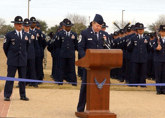 Chief Master Sergeant of the Air Force Rodney McKinley, addresses the audience, including more than 700 Airmen preparing to graduate from basic military training during the Jan. 2 dedication ceremony of the new Enlisted Heroes Walk at Lackland Air Force Base, Texas. (U.S. Air Force Photo/Alan Boedeker)