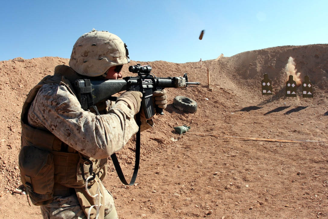 Lance Cpl. Eric Rondeau, a rifleman with Company G, 2nd Battalion, 25th Marine Regiment, Regimental Combat Team 5, participates in a company shooting competition at Combat Outpost Akashat in western al-Anbar province Jan. 4.  The company participates in a variety of athletic and skill competitions to maintain readiness and morale.
