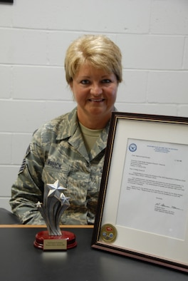 Chief  Master Sgt. Wanda Wawruck, 103rd Airlift Wing personnel superintendant, proudly displays the Department of Defense Trailblazer Award September 17, 2008, at the Bradley Air National Guard Base, East Granby, Connecticut.  Wawruck was formally recognized for her exceptional career achievements and presented the award during a March 2008 reception at the Women's Art Museum in Washington, D.C.  (U.S. Air Force photo by Staff Sgt. Erin McNamara)
