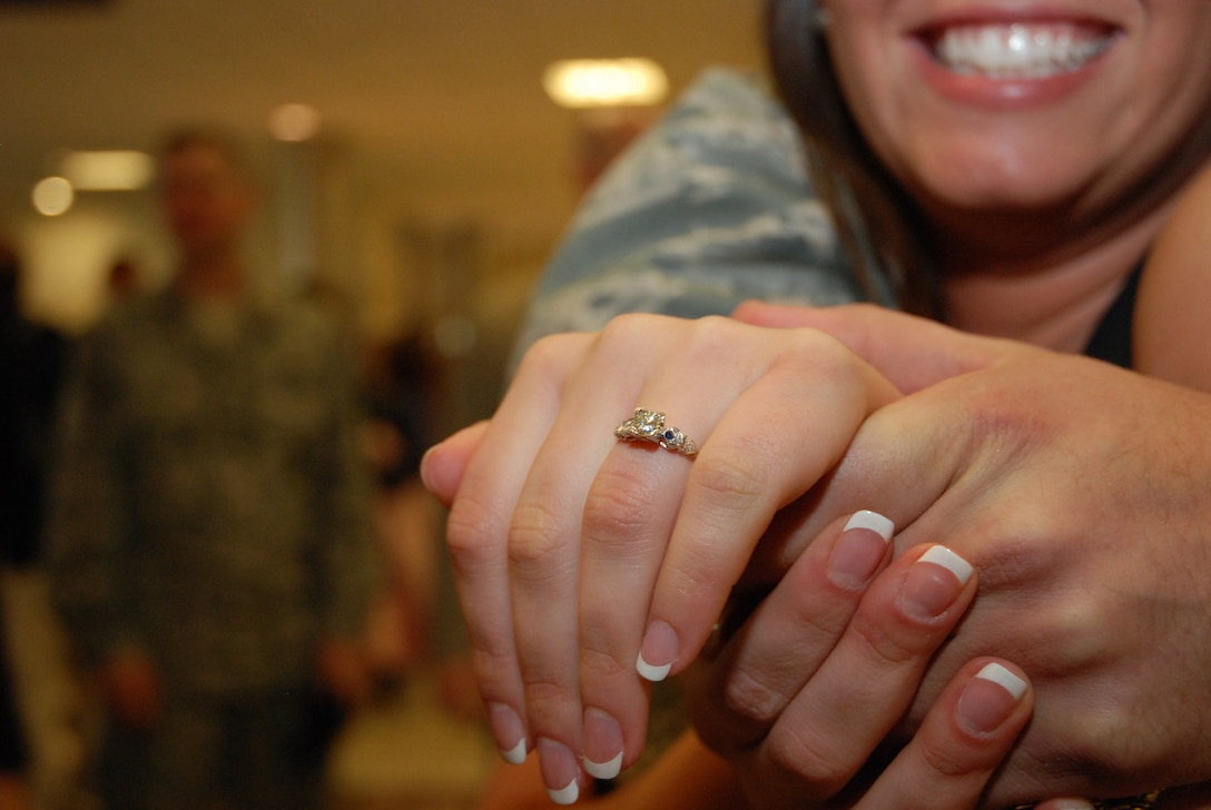 """McCalla Aragon shows off her engagement ring at the Atlanta Hartsfield-Jackson Airport Jan. 5. Senior Airman Kuhlman proposed to Ms. Aragon immediately after getting off the plane.  Half a dozen Security Forces Airmen returned home from a six-month deployment to Southwest Asia in support of Operation Iraqi Freedom. """"It feels great to have him back,"""" said the future Ms. Kuhlman. """"The first thing I wanted to do was give him a great big hug."""" (U.S. Air Force photo/Master Sgt. Stan Coleman)"""