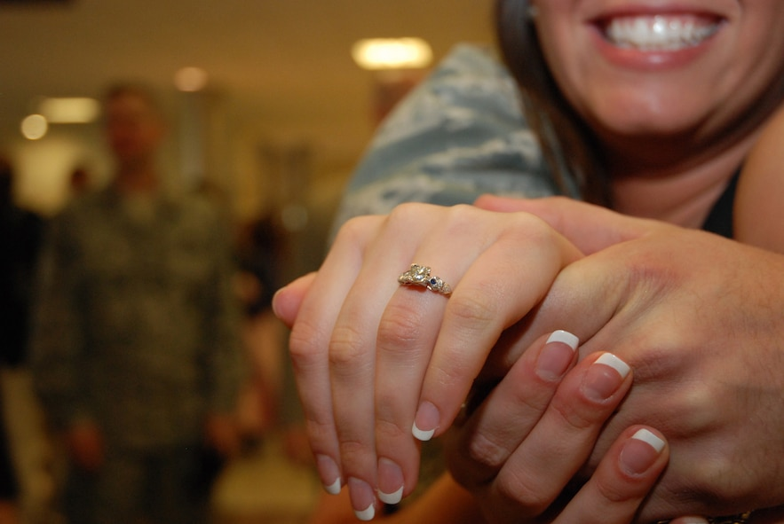 "McCalla Aragon shows off her engagement ring at the Atlanta Hartsfield-Jackson Airport Jan. 5. Senior Airman Kuhlman proposed to Ms. Aragon immediately after getting off the plane.  Half a dozen Security Forces Airmen returned home from a six-month deployment to Southwest Asia in support of Operation Iraqi Freedom. ""It feels great to have him back,"" said the future Ms. Kuhlman. ""The first thing I wanted to do was give him a great big hug."" (U.S. Air Force photo/Master Sgt. Stan Coleman)"
