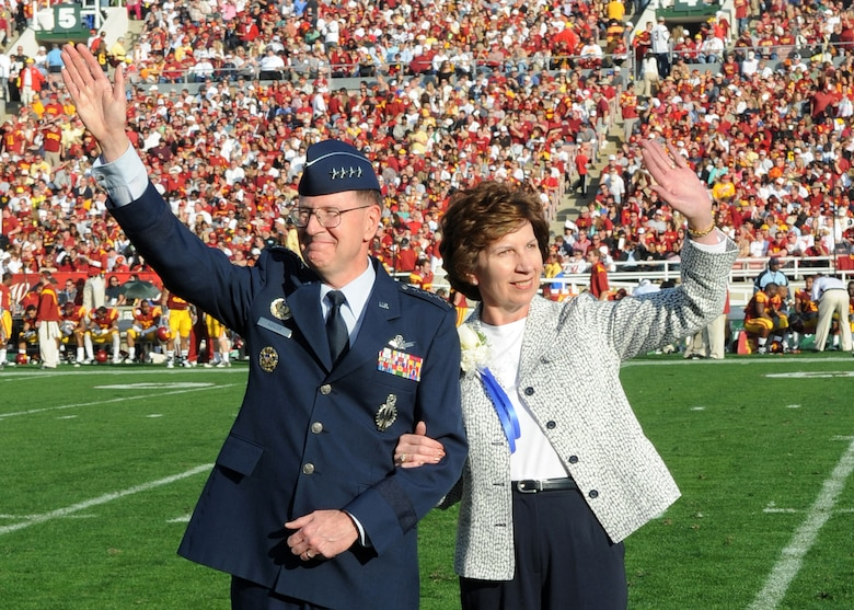 General C. Robert Kehler, Air Force Space Command commander, and his wife are acknowledged during the 95th Rose Bowl game in Pasadena, Calif., Jan. 1. The Los Angeles Air Force Base Honor Guard presented the colors during the National Anthem. General Kehler, Lt. Gen Tom Sheridan, Space and Missile Systems Center commander, Brig, Gen. Garrett Harencak, 509th Bomb Wing commander, and their spouses represented the Air Force during the 120th annual Tournament of Roses Parade and 95th Rose Bowl games. (Photo by Atiba Copeland)