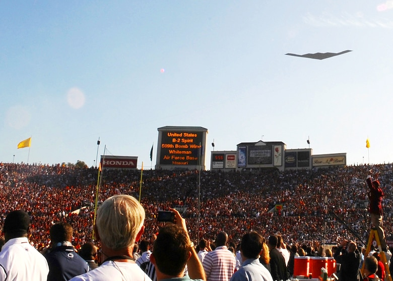 """A B-2A """"Spirit"""" stealth bomber based at Whitman Air Force Base flies over the Rose Bowl stadium during the pregame festivities for the 95th Rose Bowl game, Pasadena, Calif., Jan. 1. The Los Angeles Air Force Base Honor Guard presented the colors during the National Anthem. Gen. C. Robert Kehler, Air Force Space Command commander, Lt. Gen Tom Sheridan, Space and Missile Systems Center commander, Brig, Gen. Garrett Harencak, 509th Bomb Wing commander, and their spouses represented the Air Force during the 120th annual Tournament of Roses parade and 95th Rose Bowl games. (Photo by Atiba Copeland)"""