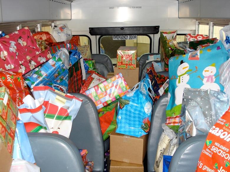 Members Of 402nd CMXG Give To Christmas Angel Program