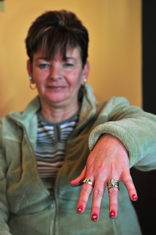 Cindy Barnhill shows off her patriotic fingernails at a Starbucks Coffee store in Centennial Colo., Dec. 29, 2008. In a personal mission spanning two and a half years, Barnhill, of Parker, Colo., has singlehandedly purchased more than $15,000 worth of coffee for service members and first responders in the two communities south of Denver. (Official U.S. Air Force photo by Tech. Sgt. Cheresa D. Theiral, Colorado National Guard) (Released)