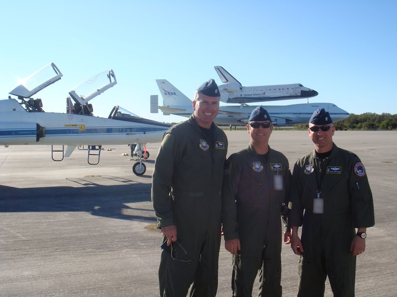 Lt. Col. Mike Tillema, Lt. Col. Robert Lindsay, Lt. Col. Dave Impiccini with the shuttle after its successful landing at Kennedy Space Center. (U.S. Air Force photo courtesy of Lt. Col. Mike Tillema)