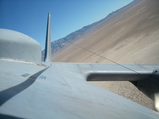 The Nevada desert is in the rear view of a 37th Airlift Squadron C-130 while it participates in the Mobility Air Forces Exercise near Nellis Air Force Base, Nov. 19, 2008. (U.S. Air Force photo by Capt. Mike Trimble)