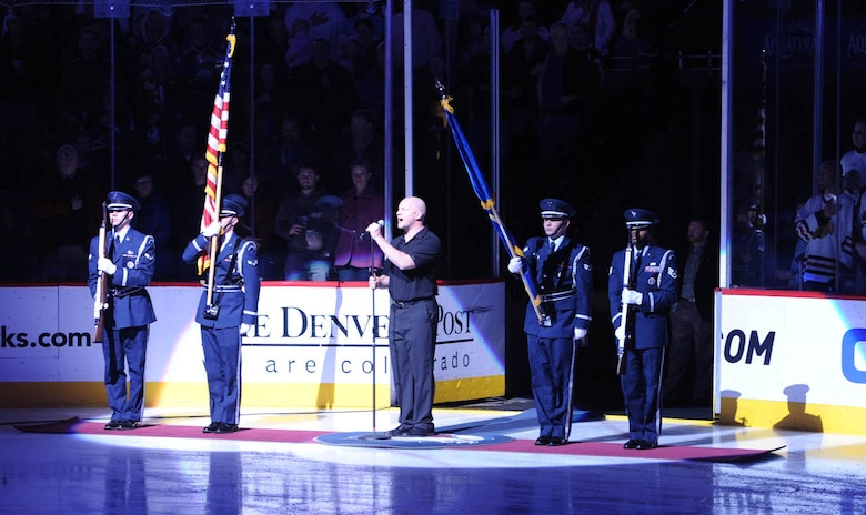 DENVER -- Buckley Air Force Base Honor Guard members, Airman 1st Class' Justin Donnenwerth, Brennen Bogle, Senior Airman Zachary Parker and Staff Sgt. Emmanuel Guerrier post the colors as the Star Spangled Banner is sung before the Colorado Avalanche faced off against the Chicago Blackhawks on military appreciation night at the Pepsi Center, Jan. 8. The team allowed Buckley members to vote on the game they would like to see. (U.S. Air Force photo by Senior Airman Christopher Bush)