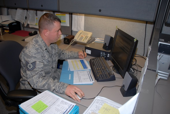 SCOTT AIR FORCE BASE, Ill. - Tech. Sgt. Kinney Schroll, part of the C-130 Weapons System Management Team, ensures all parts are available to keep C-130 Hercules aircraft mission capable.  Schroll is assigned to the 635th Supply Chain Management Squadron at Scott AFB, Ill.  The squadron is a classic association with active duty Air Force and is attached to the 126th Air Refueling Wing, Illinois Air National Guard.