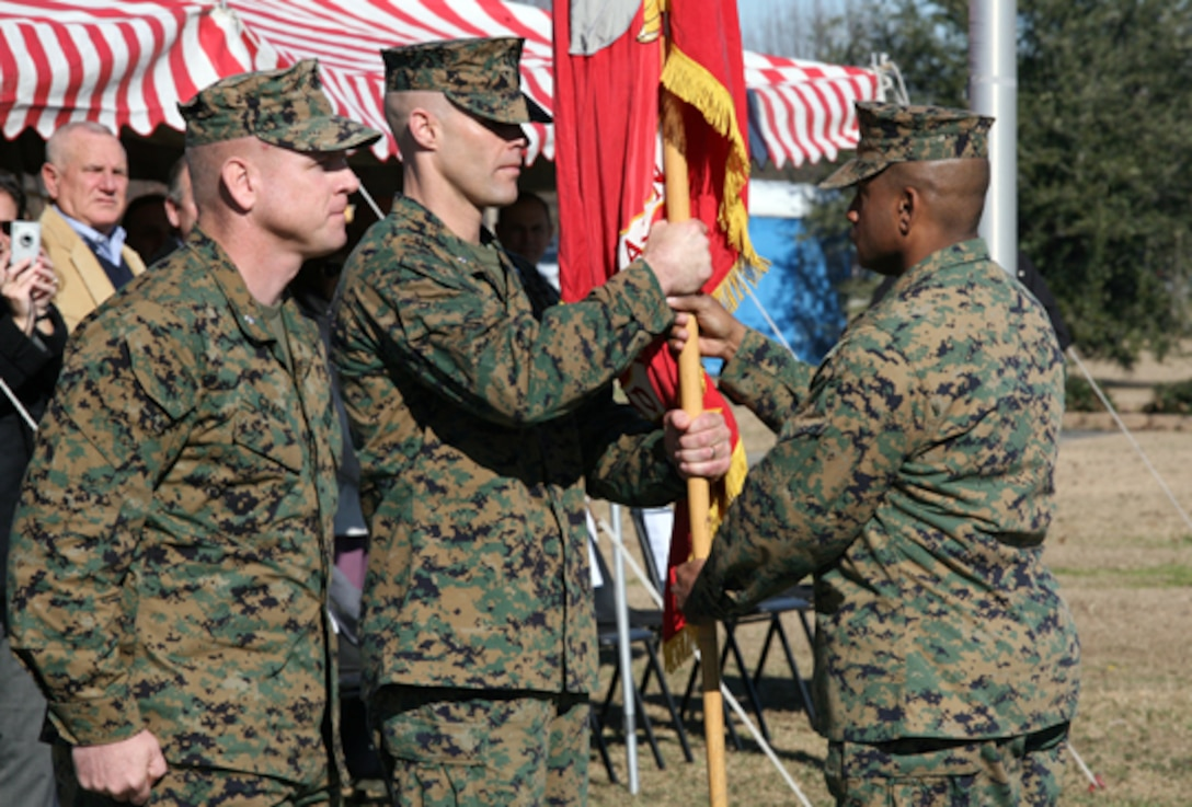 Sgt. Major Howard K. Long, Battalion Sgt. Major for 2nd Battalion, 2nd Marine Regiment, takes the guide-on from incoming Battalion Commander, Lt. Col. John E. McDonough in a change-of-command ceremony at W.P.T. Hill Field here January 9th. Relinquishing his command of the battalion was Lt. Col. Steven J. Grass. (Official Marine Corps photo by Lance Cpl. Brian M. Woodruff) (RELEASED)