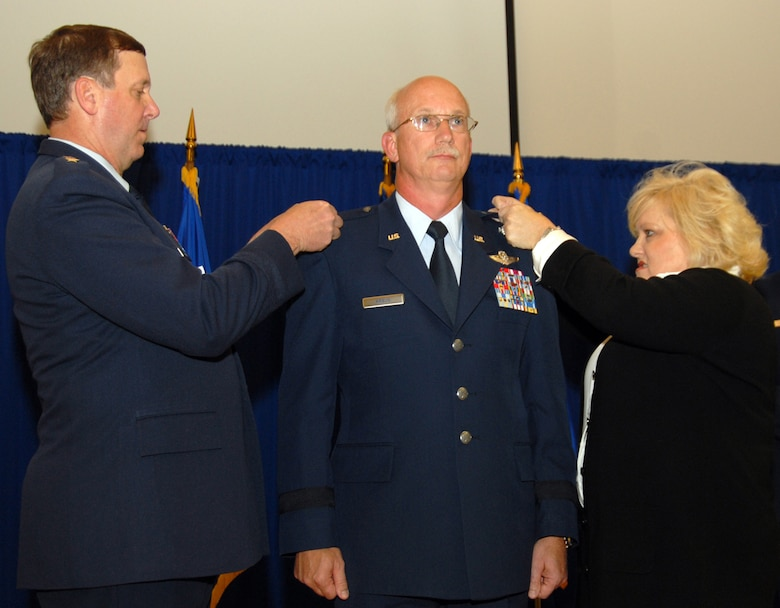 Brig. Gen. Mark Kraus, assistant adjutant general for Air, is 'pinned' with