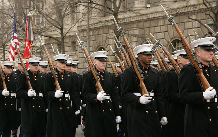 Marine Corps participants in the 56th Presidential Inaugural Parade Rehearsal march down Pennsylvania Ave. NW while displaying the American flag and Marine Corps Battle Colors Jan 11.