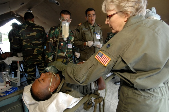 KHARROUBA AIR BASE, Tunisia -- U.S. Air Force Lt. Col. Margaret Schmidt (right), Chief Nurse from the 459th Aeromedical Evacuation Squadron, Andrews Air Force Base, Md., applies a simple face oxygen mask to a simulated victim during a mock Nov. 17 during Medlite 2008. Medlite is a Joint Chiefs of Staff Exercise designed to provide and exchange medical skills, techniques and procedures between members of the U.S. Air Force, U.S. Army and Tunisian Military Health Services. (U.S. Air Force photo/Senior Airman Erica Knight)
