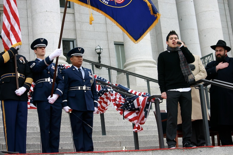 American Idol finalist David Archuleta sings the National Anthem at the 2009 Utah Governor Inauguration of Jon Huntsman, Jr. on Jan. 5, 2009. Utah Army and Air National Guard members supported the event located on the steps of the Utah State Capitol building.
