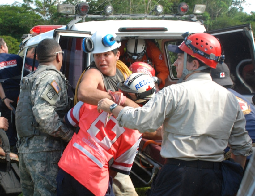 SAN MIGUEL, COSTA RICA—Members of the Costa Rican Red Cross load an earthquake victim with a broken leg into an ambulance here Saturday. The man was rescued by Joint Task Force-Bravo personnel via Blackhawk helicopter. Four JTF-Bravo helicopters and 34 servicemembers are deployed here from Soto Cano Air Base, Honduras, at the request of the Costa Rican government in order to provide life-saving support to those affected by the earthquake.  (U.S. Air Force photo/1st Lt. Candace Park)