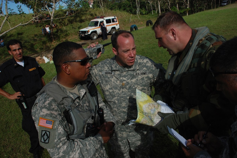 SAN MIGUEL, COSTA RICA--Members of Joint Task Force-Bravo review areas to search for victims of a magnitude 6.1 earthquake near here. Four JTF-Bravo helicopters and 34 servicemembers are deployed here from Soto Cano Air Base, Honduras, at the request of the Costa Rican government to provide life-saving support to those affected by the earthquake.  (U.S. Air Force photo/1st Lt. Candace Park)