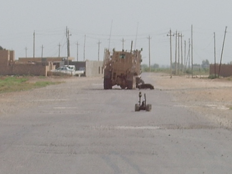 This photo shows the robot approaching an Army vehicle that was hit by an improvised explosive device (IED).  (U.S. Air Force photo courtesy Staff Sgt. Kimberly Mahan)