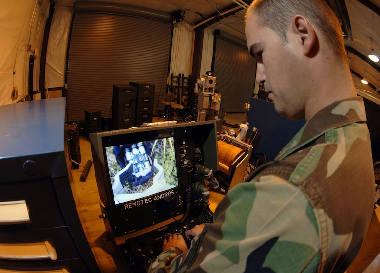 Robotic devices have lessened the danger of handling suspicious packages and unexploded ordnance. An EOD specialist remotely works on a dangerous device (U.S. Air Force photo)