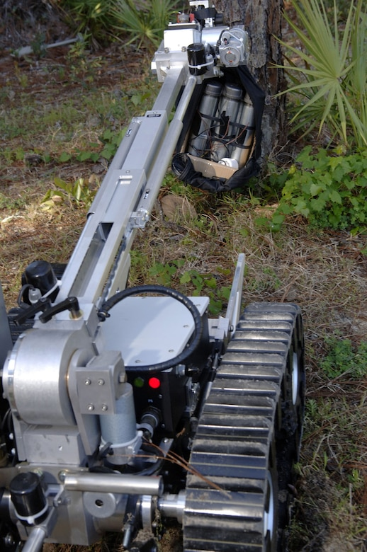 Robotic devices have lessened the danger of handling suspicious packages and unexploded ordnance. This photo highlights using a camera attached to the robot. (U.S. Air Force photo)