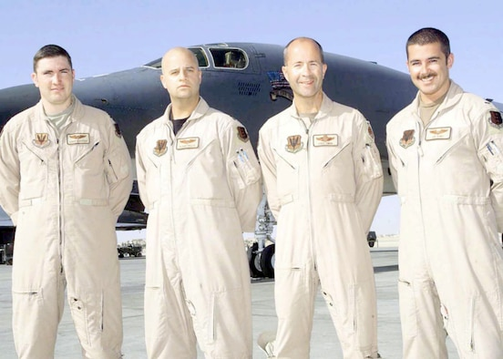 On April 7, 2003, a B-1B Lancer crew from the 28th Bomb Wing quickly found and destroyed a newly-identified high-value target. Pictured are the crew (left to right): Capt. Chris Wachter, Capt. Sloan Hollis, Lt. Col. Fred Swan and 1st Lt. Joe Runci. (U.S. Air Force photo)