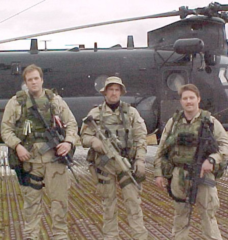 (From left to right) Tech. Sgt. Keary Miller, Senior Airman Jason Cunningham and Staff Sgt. Gabe Brown about three weeks before the battle. Behind them is a MH-47E, the same type of helicopter that took them to Takur Ghar. (U.S. Air Force photo)