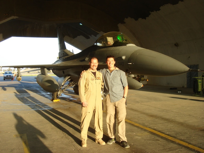 At the end of his tour in Iraq, Sgt Wallace (right) visited Maj Marquardt (left).  They are standing in front of the F-16 Marquardt flew that day.