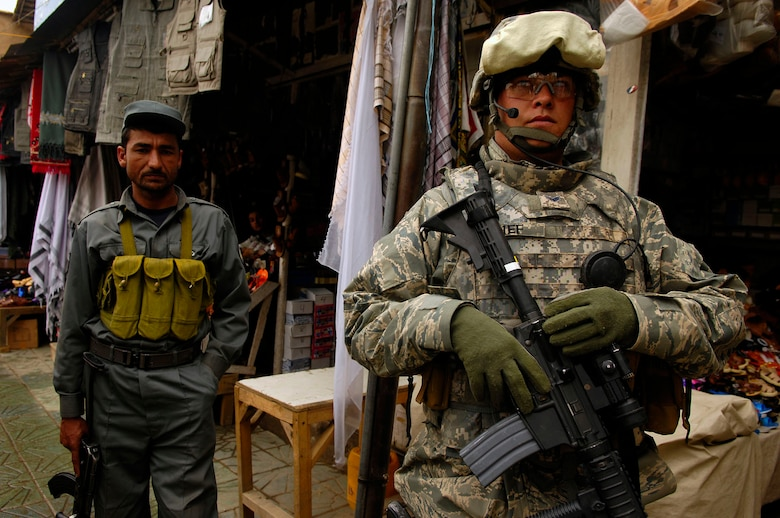 Senior Airman Andrew Kief, 56th Security Forces Squadron, on a foot patrol in Charikar, Afghanistan in April 2008. Kief is a member of the Police Advisory Team, Provincial Reconstruction Team. (U.S. Air Force photo)