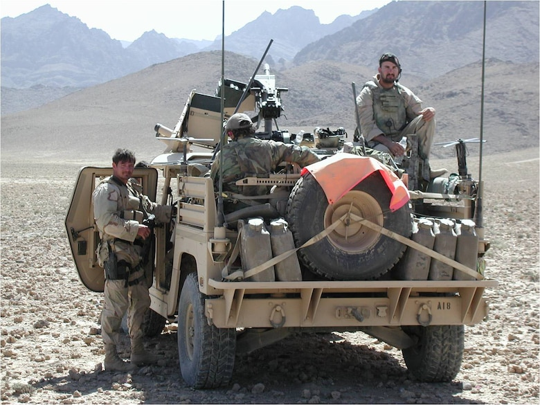 Tech. Sgt. Kevin Whalen (right) sitting on a Special Forces Humvee in Afghanistan. To his right is a Mk 19 automatic grenade launcher mounted on the vehicle. (U.S. Air Force photo)