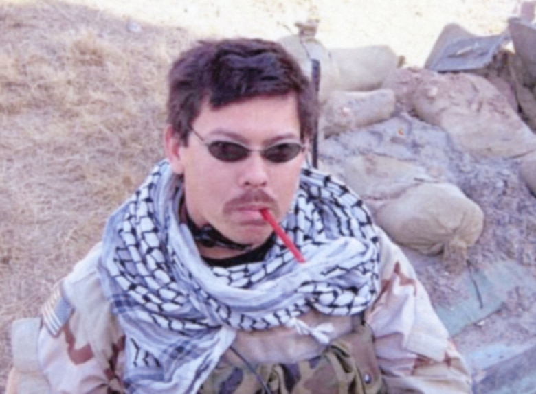 Staff Sgt. Rich Brake, JTAC who served three tours in Iraq, taking a moment to eat some candy just before a mission against a high value target in Samarra, Iraq in February 2005. He is wearing the keffiyeh (also called a shemagh) now on display at the National Museum of the United States Air Force. Keffiyehs are commonly worn in the Middle East to provide protection against the sun and blowing sand, and to identify one's social position and group. (U.S. Air Force photo)