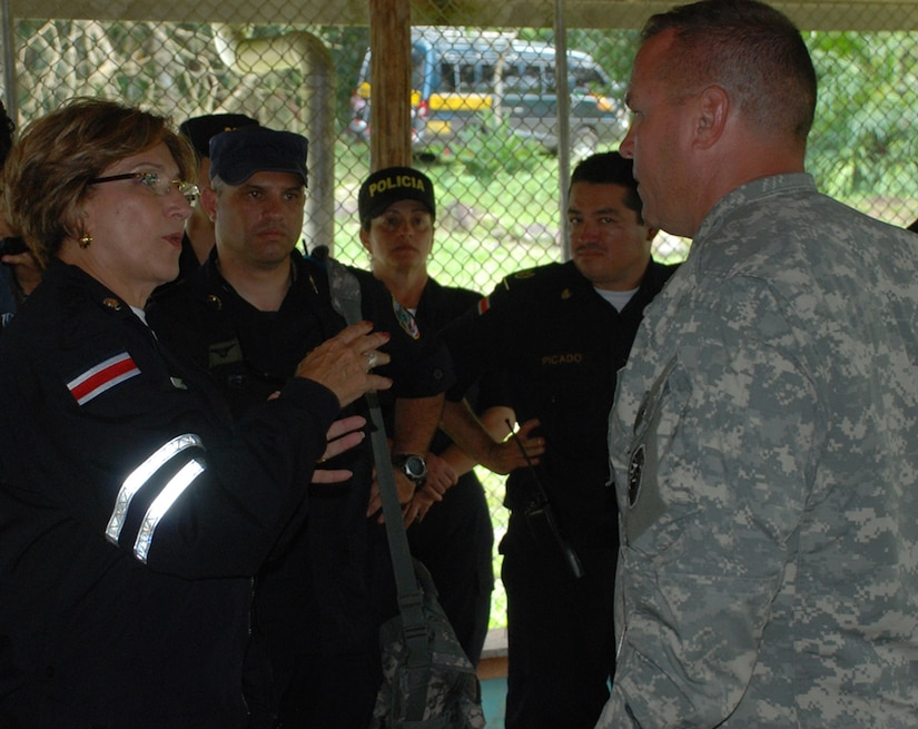 SAN MIGUEL, COSTA RICA--Marcela Chacon, vice minister of public security for Costa Rica, thanks Army Lt. Col. Richard Somers, task force commander deployed here, for Joint Task Force-Bravo's assistance in the disaster response operation. Four helicopters and 34 servicemembers from JTF-Bravo are deployed here at the request of the Costa Rican government to provide humanitarian assistance. (U.S. Air Force photo/1st Lt. Candace Park)