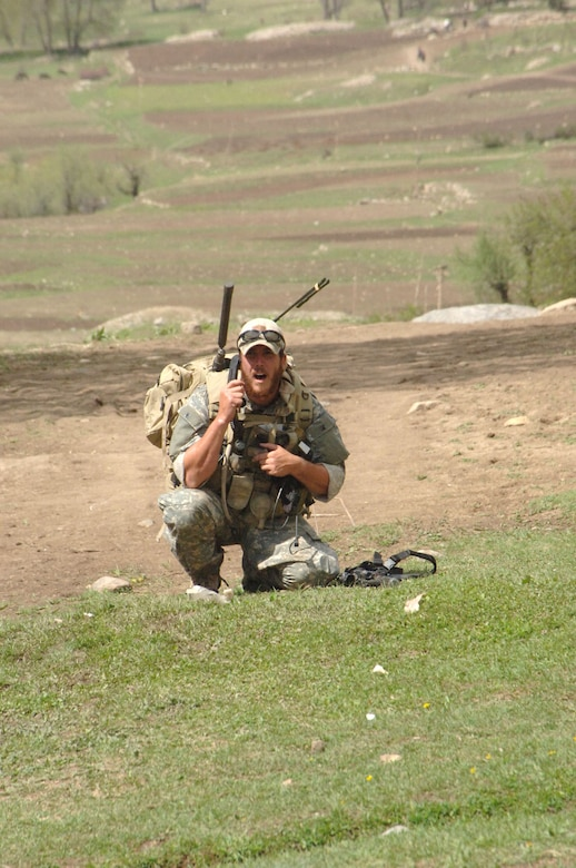 Air Force Joint Terminal Attack Controller (JTAC) talking on the radio in support of a U.S. Army Special Forces team in Afghanistan. (U.S. Air Force photo)