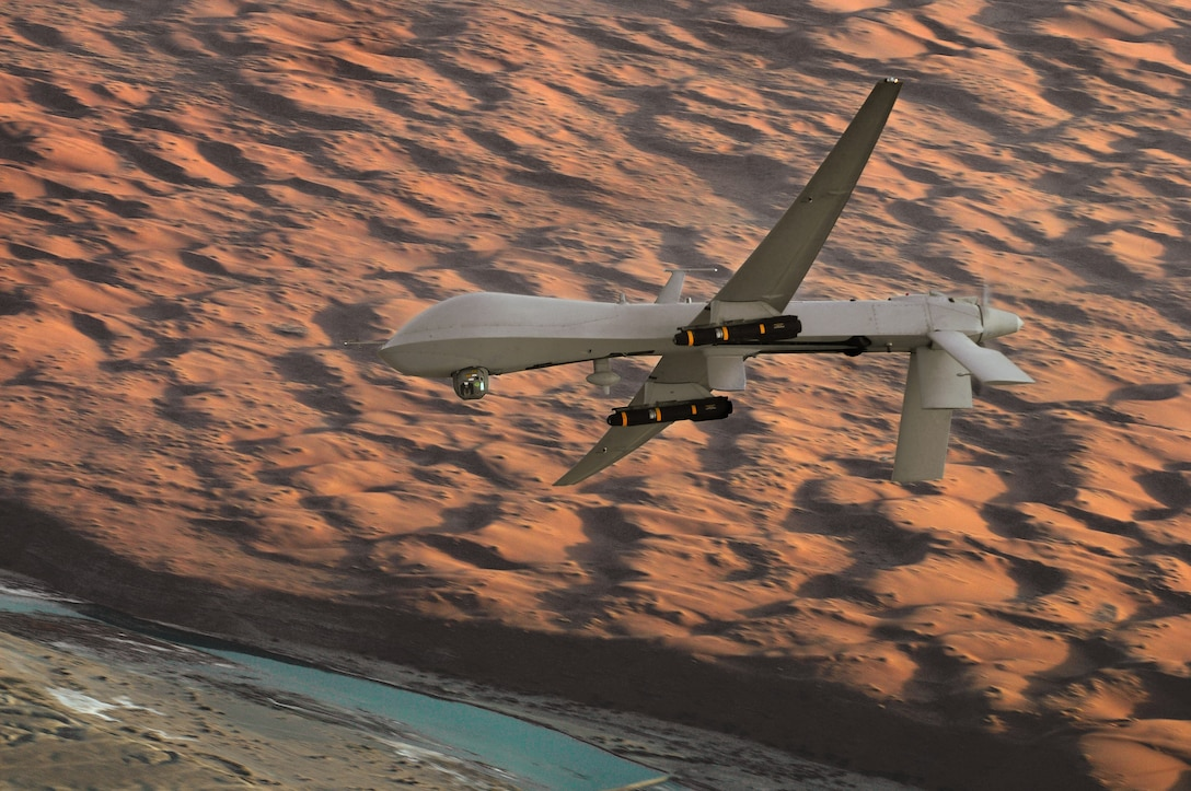 An MQ-1 Predator unmanned aircraft, armed with AGM-114 Hellfire missiles, flies a combat mission over southern Afghanistan.  The MQ-1 is deployed in Operation Enduring Freedom providing interdiction and armed reconnaissance against critical, perishable targets. (U.S. Air Force photo/Lt. Col. Leslie Pratt)