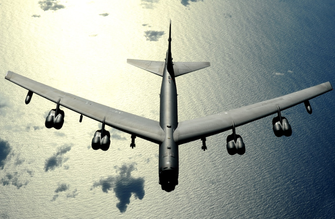 A B-52 Stratofortress flies a routine mission Nov. 12 over the Pacific Ocean. The B-52 is deployed from Minot Air Force Base, N.D., to Andersen AFB, Guam, and is part of a continuing operation of maintaining a bomber presence in the region. (U.S. Air Force photo/Master Sgt. Kevin J. Gruenwald)