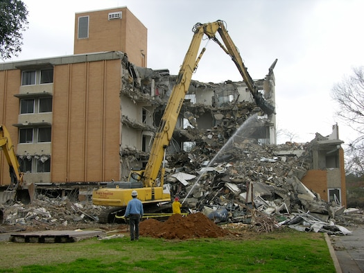 Contractors begin demolition of the old Maxwell lodging facility Monday. Building 157 served the base as billeting for more than 37 years and the area will be put on the Maxwell-Gunter general plan for possible future development. (Air Force photo by Carl Bergquist)