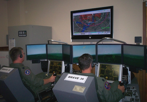 The Distributed Mission Operations system allows operators to hone their Homeland Defense skills using a combination of both real and virtual tools. Here, operators use simulators to train on a Homeland Defense scenario. (USAF Photo)