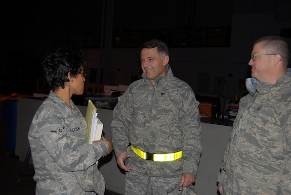 Col. John McDonald, 43rd Airlift Wing Commander, visits with Airman Melissa Jackson, 43rd Communications Squadron as she prepares to leave from building 560 for her deployment Jan 7. (U.S. Air Force Photo by Airman 1st Class Mindy Bloem)