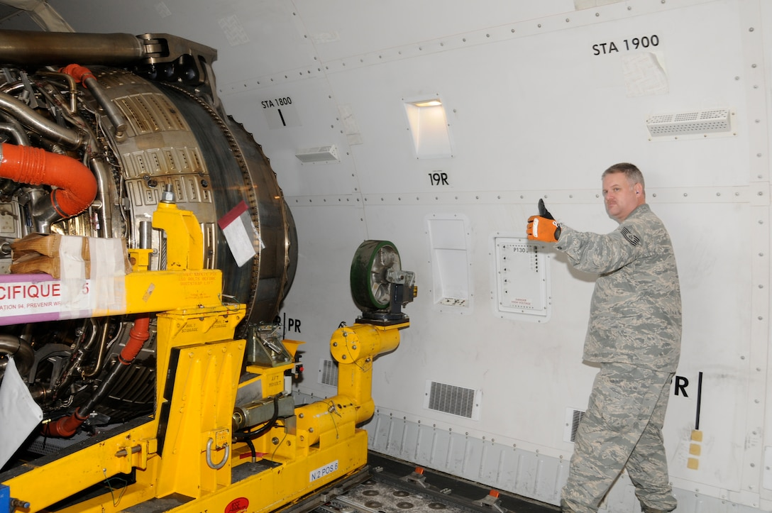 Tech. Sgt. John Christian, 729th Air Mobility Squadron, gives a thumbs up while loading a defective engine on an Air France 747 cargo plane here on Jan 13.  Last week Air Force personnel assisted the Portuguese and Air France in unloading a new engine for an Air France 777 passenger aircraft that made an emergency landing here on Jan 4. (U.S. Air Force photo by Tech. Sgt. Rebecca Corey)