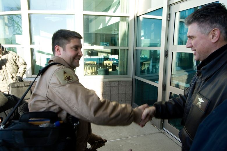 133rd Airlift Wing Commander Colonel Greg A. Haase (right) shakes hands with  Maj. Jeffrey Wong (left) upon arrival at the 133rd Operations building 14 January 2009. Major Wong piloted the Minnesota Air National Guard C-130 Hercules that returned from deployment to Afghanistan supporting Operation Enduring Freedom. (U.S. Air Force photo/Tech. Sgt. Erik Gudmundson)