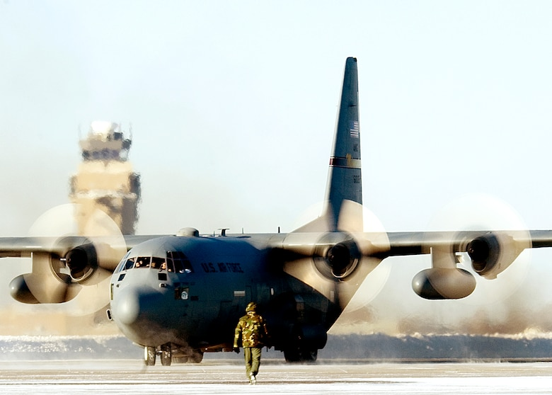 A  C-130 Hercules from the 133rd Airlift Wing, Minnesota Air National Guard, taxis down the runway at the Minneapolis St. Paul International Airport January 14, 2009.  The aircraft carried the last 29 members of the wing home after being deployed to Bagram Air Field, Afghanistan. This return marks the end of the aviation support to the Operation Enduring Freedom rotation by the 133rd Airlift Wing for this cycle. The C-130s provide intra-theater heavy airlift, delivering tons of cargo and transporting passengers in support of Operation Enduring Freedom. (U.S. Air Force photo/Tech. Sgt. Erik Gudmundson)
