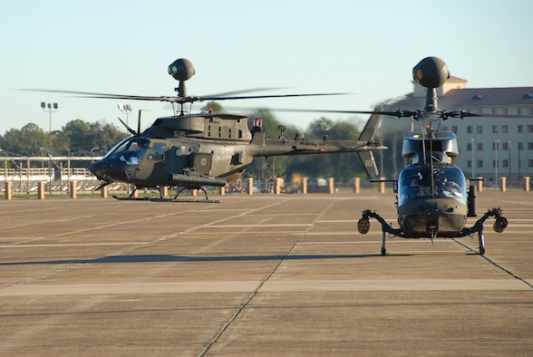 Two of more than 20 Army helicopters prepare to leave the Maxwell flight line after an overnight stay at the base Jan. 9. The aircraft were en route from Fort Bragg, N.C., to the Army's Joint Readiness Training Center at Fort Polk, La. Maxwell Air Force Base is used on a regular basis by aircrews not assigned to the base for a variety of purposes to include re-fueling and lodging. (Air Force photo by Jamie Pitcher)