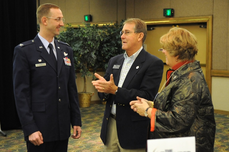 AURORA, Colo. -- Col. Wayne McGee, 460th Space Wing Commander, speaks with Ms. Nancy Todd, State Legislator, and her husband, Mr. Terry Todd before giving the State of the Base address at the Red Lion Hotel here Jan. 14. In 2008 Buckley injected more than $1 billion into the local economy for the fifth straight year. (U.S. Air Force photo by Senior Airman John Easterling)