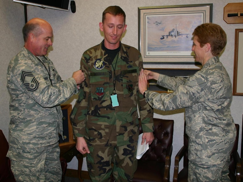 Staff Sergeant John Accola, 552nd Maintenance Squadron, was unexpectedly promoted to technical sergeant by Col. Pat Hoffman, commander, 552 ACW and Chief Master Sgt. Larry Gooch, 552 MXG, while hard at work December 19, 2008.
