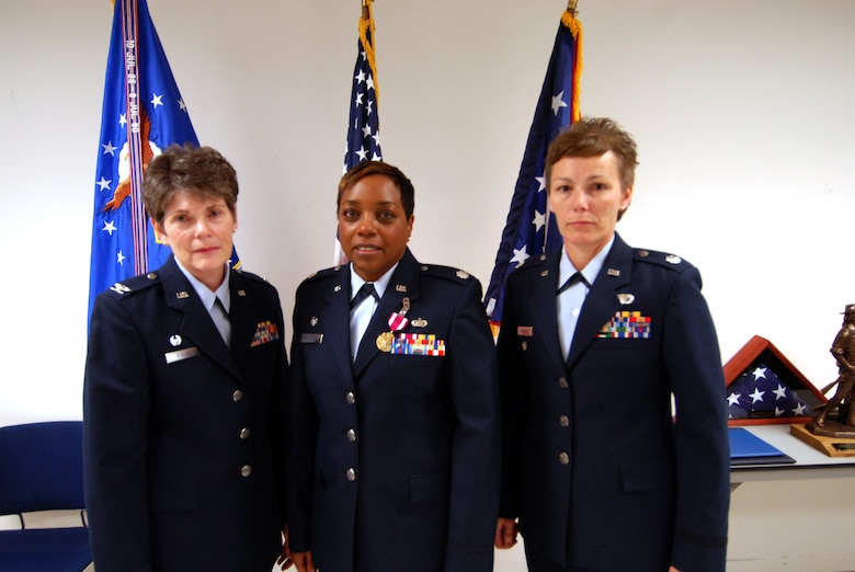Another 180th and Ohio First – Mission Support Flight (MSF) Change of Command Ceremony consisted of three female commanders – Mission Support Group Commander, Col Nancy August; retiring MSF/CC LtCol MaryThom Williams and new MSF/CC, LtCol Chris Rowzee. USAF Photo by Airman First Class Amber Williams