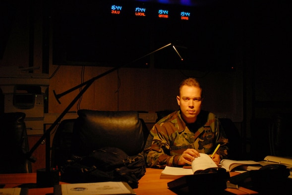 Master Sgt. Matthew Ulichney, 835th Civil Engineer Squadron, steals study breaks in the emergency operations center between the end of the duty day and his evening classes. Inspired by his former supervisor, Maj. Rodolfo Rodriguez, to go back to school, he finished two degrees with the Community College of the Air Force in December and is already enrolled in a bachelor's program. Major Rodriguez was killed in a terrorist bombing in Pakistan last September. (U.S. Air Force photo by Capt John Ross)