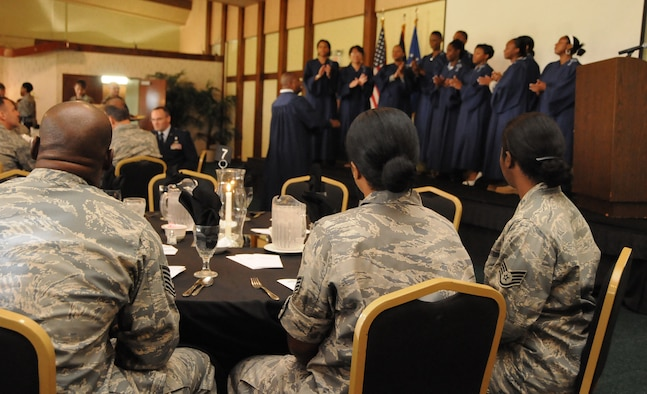 ANDERSEN AIR FORCE BASE, Guam - Guests of the Dr. Martin Luther King Jr. Remembrance Breakfast enjoy some gospel music by the IGS Gospel Choir, directed by retired Senior Master Sgt. Michael Williams here Jan. 15. Capt. Robert Lee III wrapped up the breakfast by giving a few words on Dr. Martin Luther King Jr. (U.S. Air Force photo by Airman 1st Class Courtney Witt)