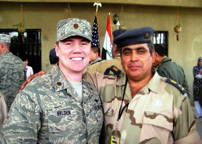 Maj. Dan Belden (left) served 18 months with the Coalition Air Force Training Team in Baghdad, Iraq, and assisted in the reconstruction of the Iraqi's Air Force from the ground up. He was awarded the Bronze Star Medal for his efforts. (Courtesy photo)