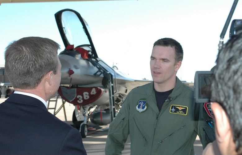Maj. Olde Bijvank, a Royal Netherlands Air Force F-16 pilot, interviewes on the Operation Snowbird ramp at Davis-Monthan Air Force Base with KOLD, Channel 13, reporter J.D. Wallace about flying in Southern Arizona, Jan. 14. Major Bijvank, an instructor pilot with the Ohio Air National Guard, trained at the 162nd Fighter Wing at Tucson International Airport as a student pilot 12 years ago. He noted that the weather, ranges and the support of the Arizona Guard amount to ideal pilot training conditions here. The Dutch will train at Operation Snowbird Jan. 11-31 with Ohio's 178th Fighter Wing to escape winter weather conditions in the north. (Air National Guard photo by Capt. Gabe Johnson)