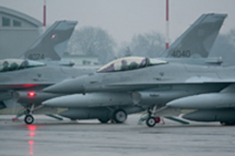 "Pilots from the Arizona Air National Guard's 162nd Fighter Wing deliver the last three F-16 ""Jastrzab,"" or Hawks as their called, to the Polish Air Force at Krzesiny Air Base, Poland, Dec. 11, 2008. These jets represent the last of 48 aircraft Poland purchased as part of the ""Peace Sky"" program. Poland continues to send F-16 student pilots to the 162nd at Tucson International Airport for training. (U.S. State Department photo)"
